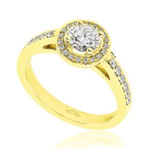 Somptueuse : Bague de fiançailles en or jaune 18k, halo épaulé de diamants. Halo et épaules serties 32 diamants G/VS total 0.15 carats.
