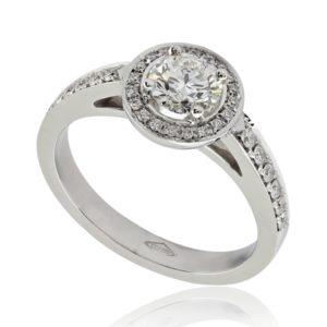 Somptueuse : Bague de fiançailles en platine, halo épaulé de diamants. Halo et épaules serties 32 diamants G/VS total 0.15 carats.