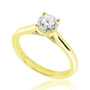 Délicate : Bague de fiançailles en or jaune 18k au pavage latéral. Pavage latéral 20 diamants G/VS.