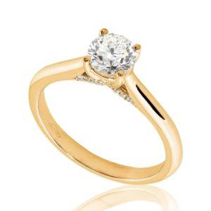 Délicate : Bague de fiançailles en or rose 18k au pavage latéral. Pavage latéral 20 diamants G/VS.