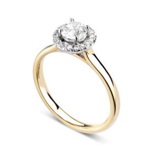 Éblouissante : Bague de fiançailles en or jaune 18k avec halo serti de diamants. Halo serti dressé 16 diamants G/VS total 0.07 carats.