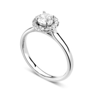Éblouissante : Bague de fiançailles en platine avec halo serti de diamants. Halo serti dressé 16 diamants G/VS total 0.07 carats.
