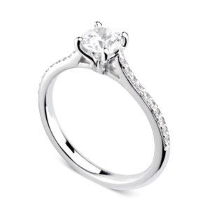 Luxuriante : Bague diamant en or blanc 18k aux épaules serties et cathédrale. Épaules serties grains 20 diamants G/VS total 0.08 carats.
