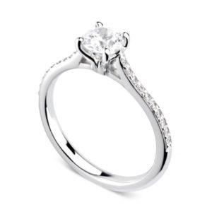 Luxuriante : Bague diamant en platine aux épaules serties et cathédrale. Épaules serties grains 20 diamants G/VS total 0.08 carats.
